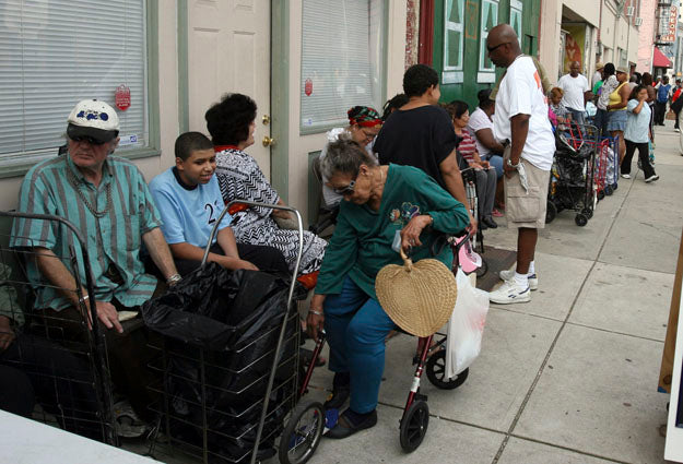 People line up for free produce at Crisis Ministry food pantry