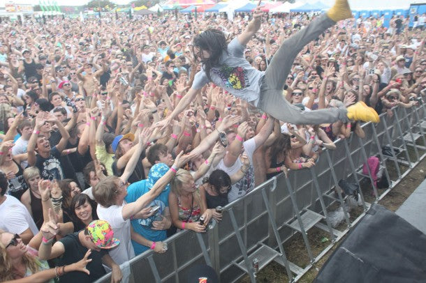 Crowd Surfing at a Music Festival