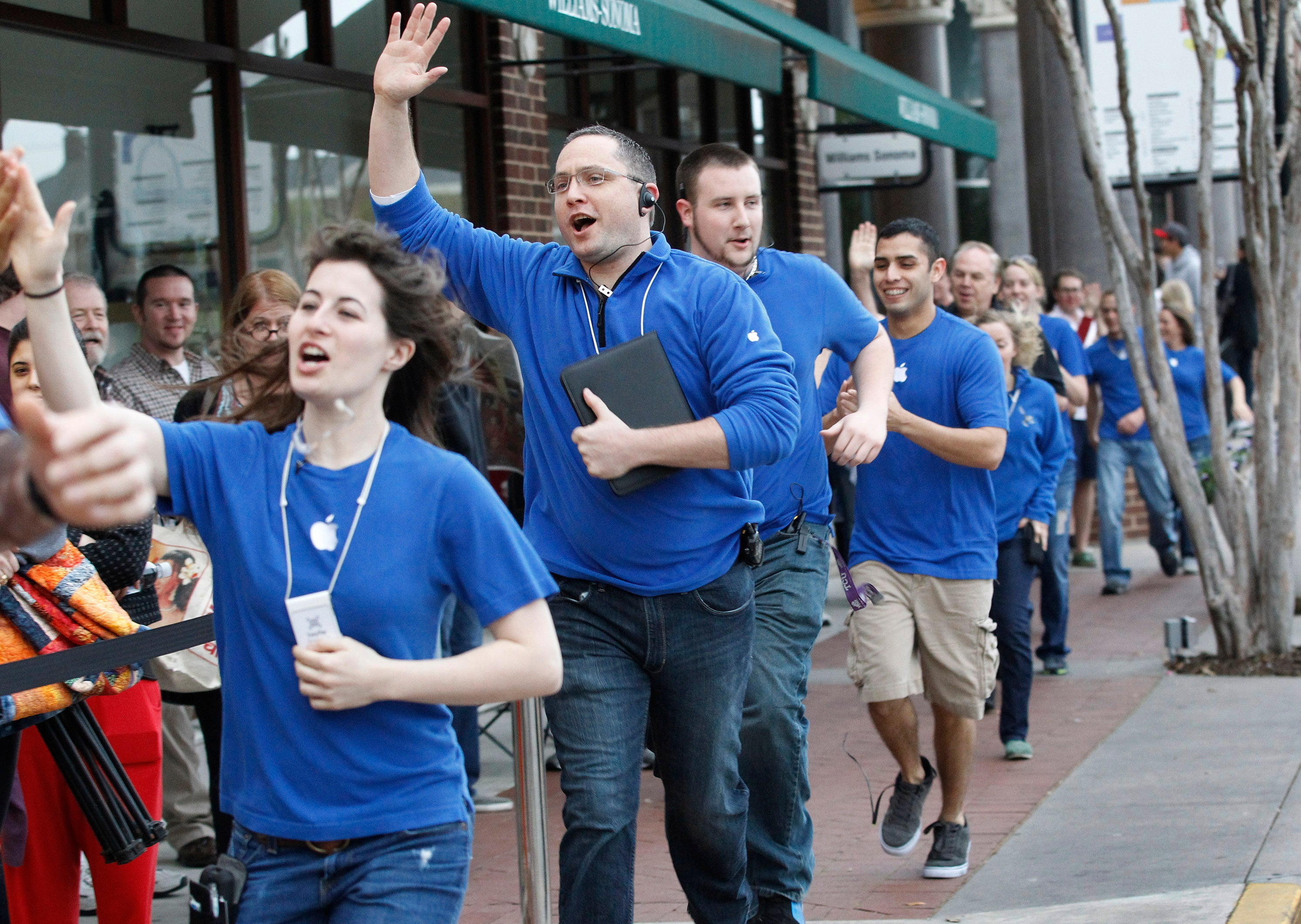 Apple Store Employees with Blue Uniforms