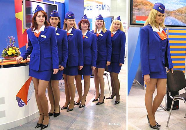 Stewardesses in Blue Dress Suits