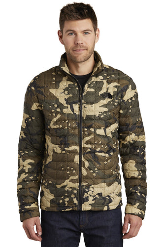 The North Face Burnt Olive Woodchip Camo Print NF0A3LH2 jackets with company logo