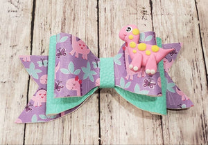 Pink Dino Clay doll faux leather bow