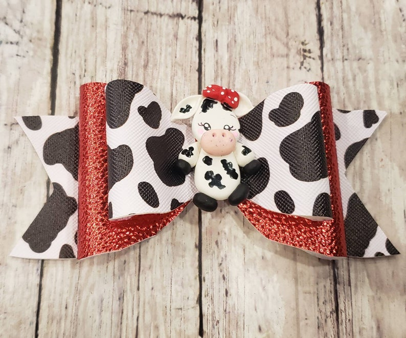 Cow Clay doll faux leather bow