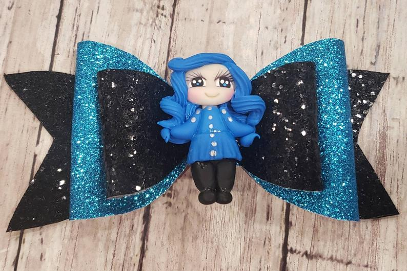 Blue girl Clay doll faux leather bow
