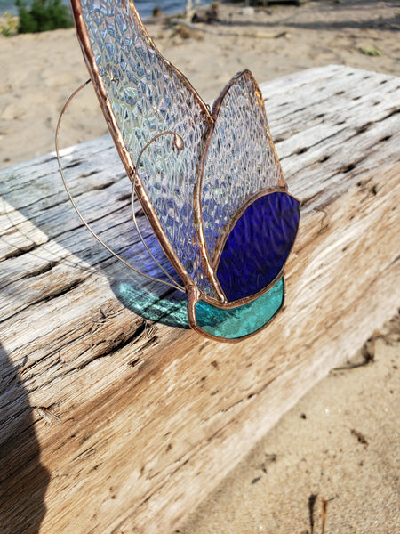 Blue stained glass butterfly with iridescent wings