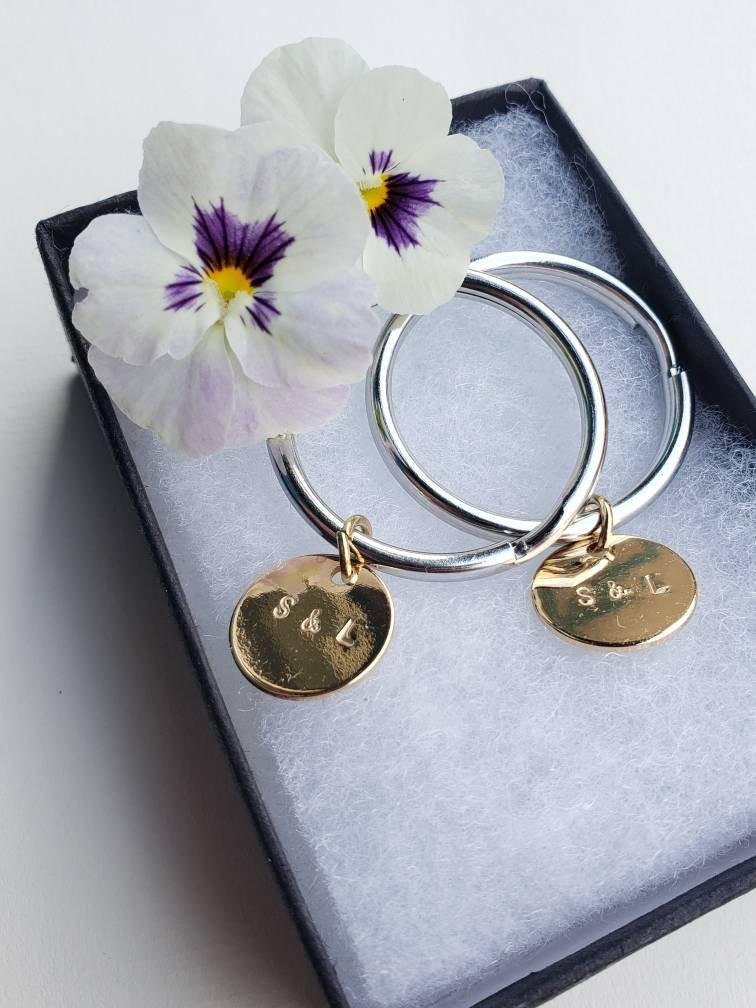 His and hers gold keychain charms with your custom initials, set of 2