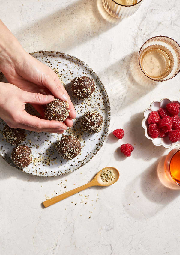 hemp protein bliss balls with a side of raspberries