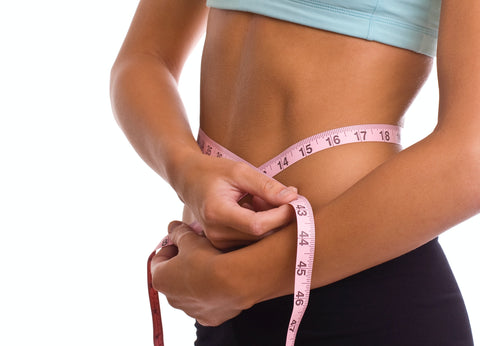 Slim-fit-woman-measuring-her-waist--size-tape-measure-close-up-slim-woman-measuring-her-waist-size-tape