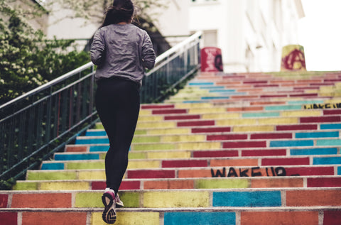 Woman-climbing-on-stairs-and-burning-calories