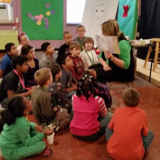 Reading to children at Norwood Grace UMC.