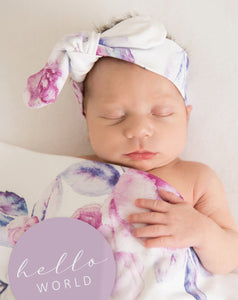 baby in a lilac swaddle