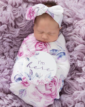 Load image into Gallery viewer, baby in a lilac swaddle with Im here sign