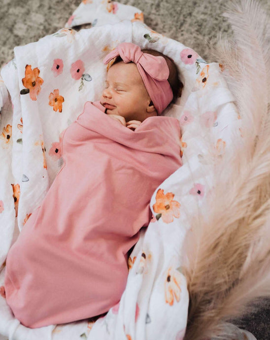 baby in a pink swaddle