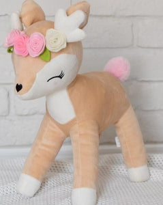 plush deer with flower crown