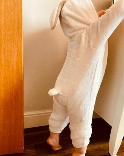 Baby in rabbit onesie
