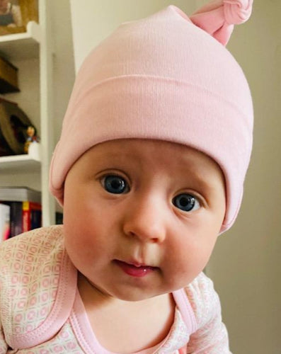 Baby in dusty Pink hat