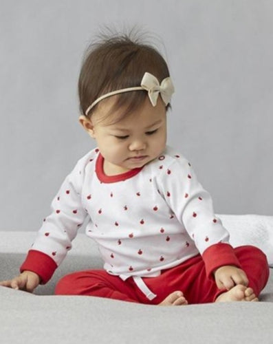 Baby in red heart pants and apple top