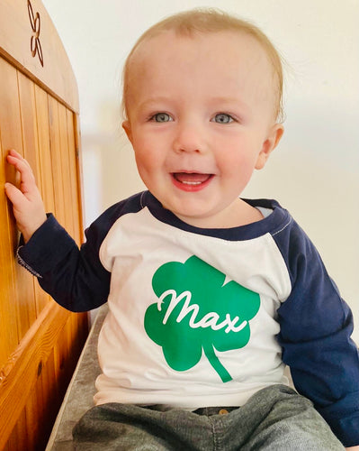 baby in a shamrock baseball top