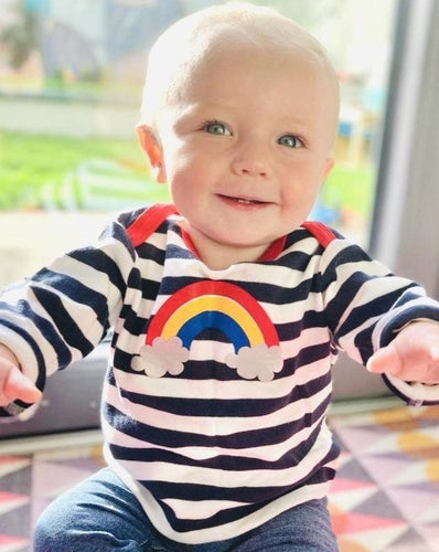 Baby in rainbow top