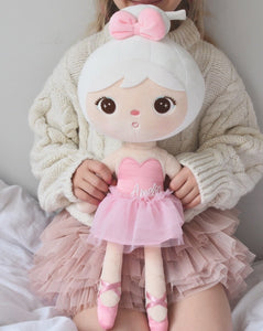 Little girl holding metoo Ballerina  doll