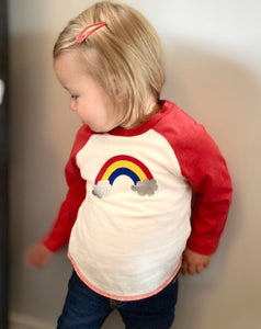 toddler in baseball rainbow top