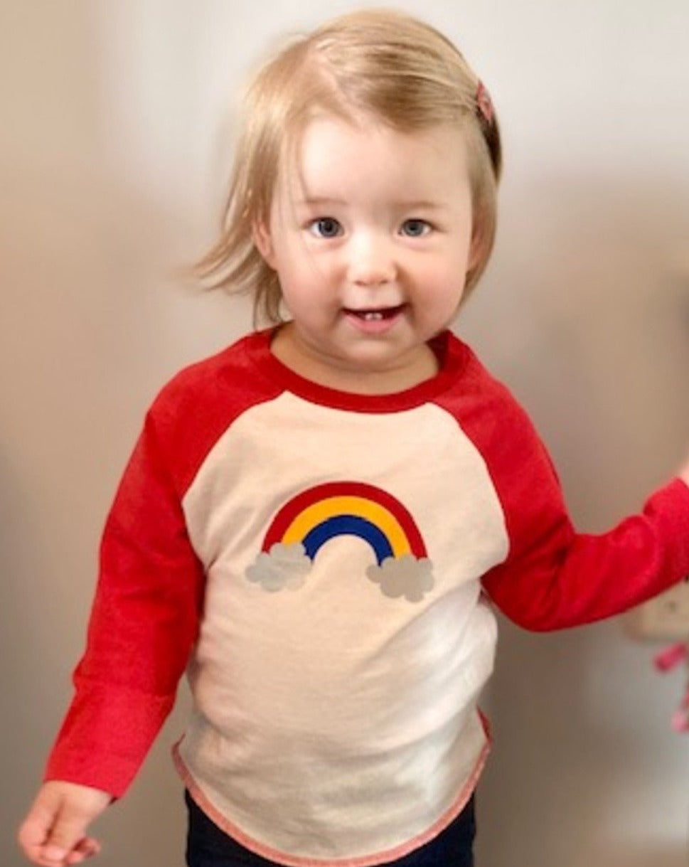 Toddler in Rainbow baseball top