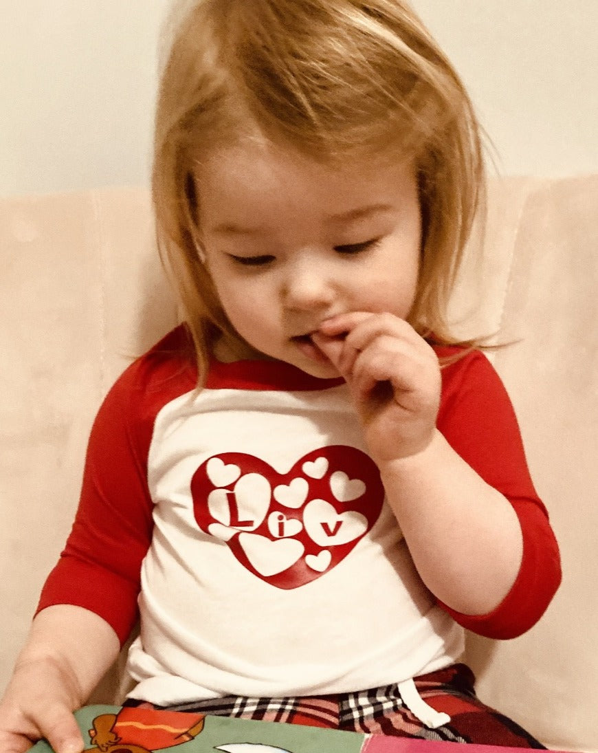 Toddler in red valentines top