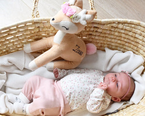 baby in basket with deer