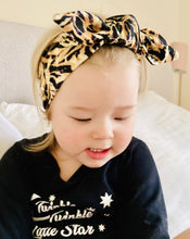 Load image into Gallery viewer, blonde toddler in animal print headband