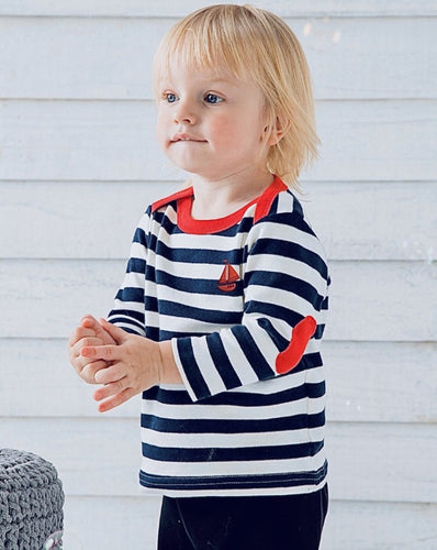 baby in a stripy sailboat tee