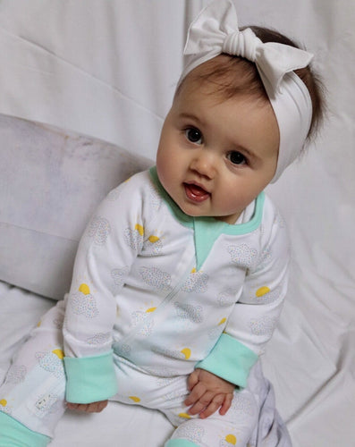 happy clouds zip romper on a baby with whitebow