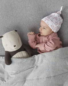 Baby in bed with bramble hat and panda