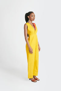 yellow jumpsuit with akwete accent by Emmy Kasbit