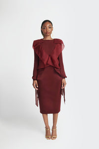 Statement blouse with exaggerated lapels and bow tie cuffs in maroon by Sukeina