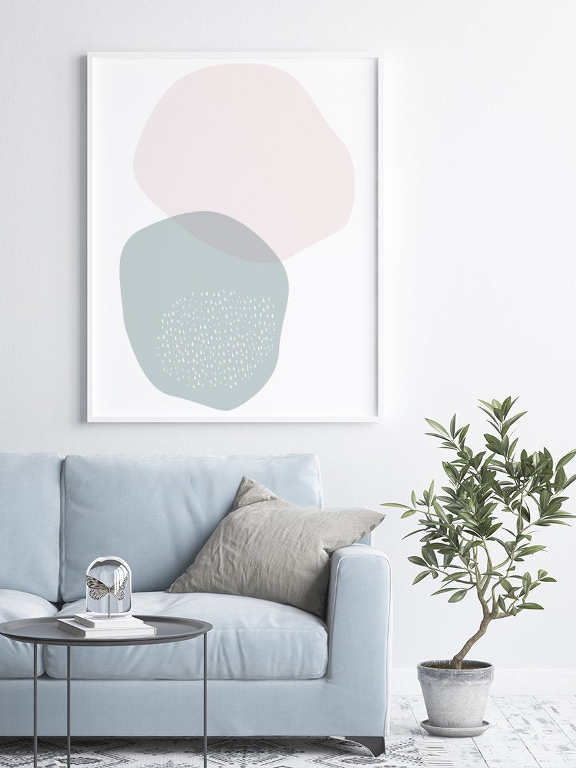 blue-and-pink-circle-pastel-shapes-poster-in-interior-living-room