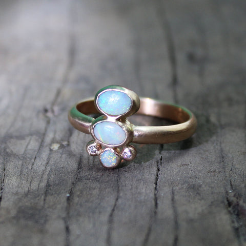 Gold ring with oval opals and accent diamonds