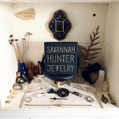 Altar adorned with Savannah Hunter Jewelry box, crystals, dried plants and flowers, and jewelry.