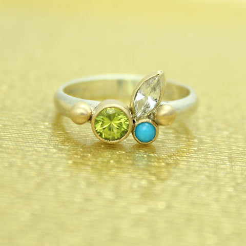 Silver ring with different shapes stones - peridot, turquoise, and white topaz