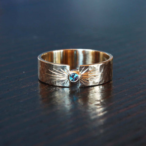 Hammered gold wedding band with purple Alexandrite and engraved details.