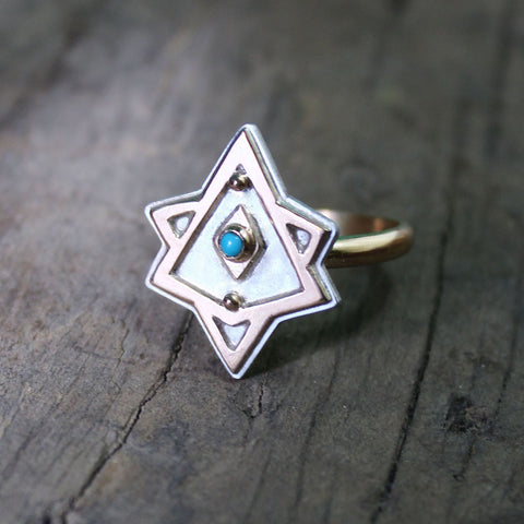 Gold and silver merkaba shaped ring with turquoise stone