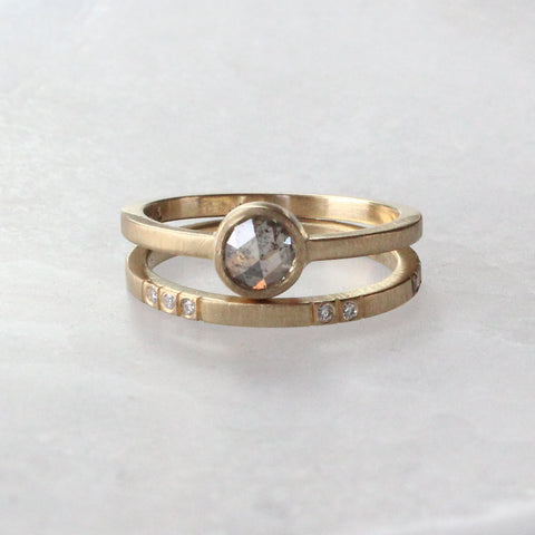 Gold engagement ring with rose cut gray diamond and diamond wedding band