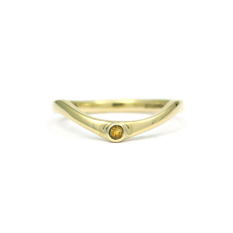 Curved gold wedding band with citrine.