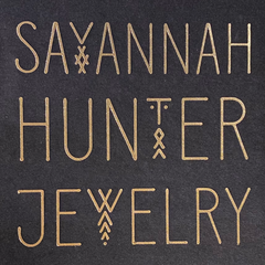 Decorative gold letters on black background that read Savannah Hunter Jewelry
