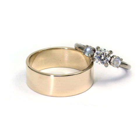 Yellow gold wedding band and white gold diamond engagement ring with moonstones