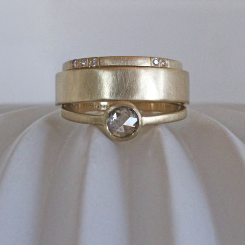 Gold engagement ring with rose cut gray diamond, wide gold wedding band,  and diamond wedding band