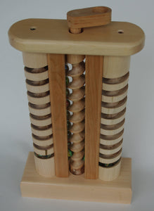 The Mother-in-Law is a wooden toy with marbles made by hand in Vermont.