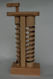 The Crank: A wooden toy with marbles hand crafted in Vermont.