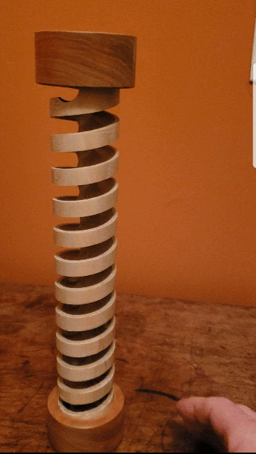 Marblelous Wooden Spiral is a handmade desktop marble wood toy.
