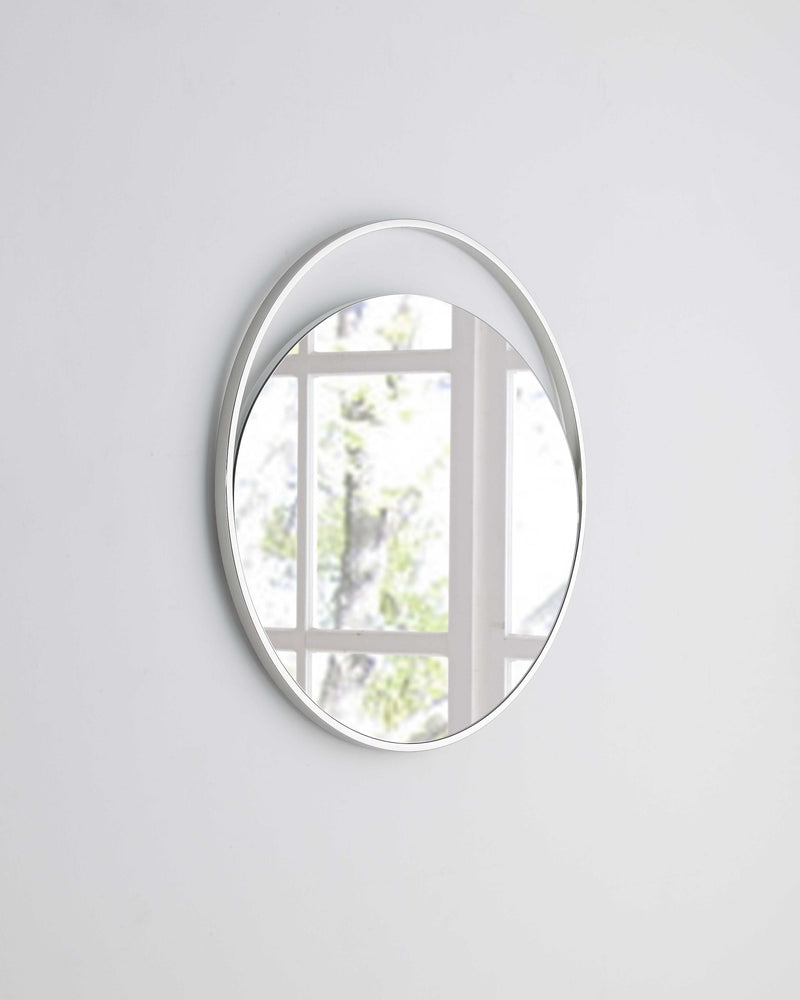 Medium Round Mirror In Matte White. Polished Stainless Steel Frame.
