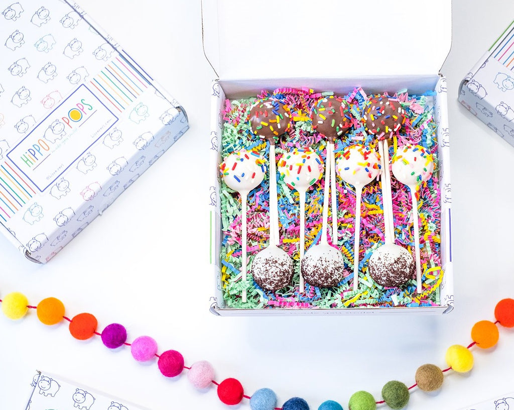 Box of chocolate, birthday and cookies & cream HippoPops cake pops with colorful crinkle paper